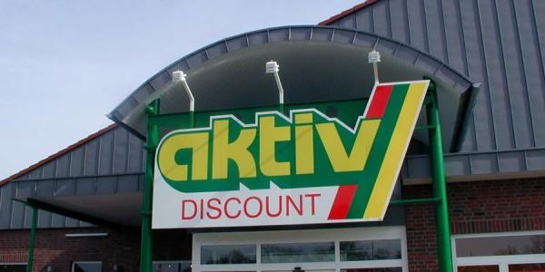 Schild mit direkter Beleuchtung von Grünewald-Werbung